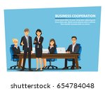 businessmen shaking hands and... | Shutterstock .eps vector #654784048