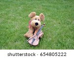 a small lovely dog doll with a... | Shutterstock . vector #654805222