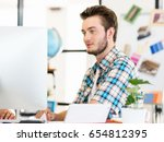 young man working in office | Shutterstock . vector #654812395