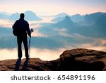 silhouette of tourist with... | Shutterstock . vector #654891196