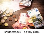 euro banknotes and coins with... | Shutterstock . vector #654891388