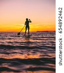 woman stand up paddle boarding... | Shutterstock . vector #654892462