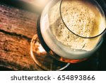 glass of fresh beer in rustic... | Shutterstock . vector #654893866