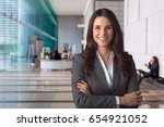smiling bank manager welcoming... | Shutterstock . vector #654921052