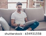 young attractive smiling guy is ... | Shutterstock . vector #654931558
