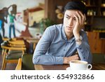 bored young asian man sitting... | Shutterstock . vector #654932866