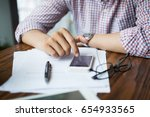 hands of young man using mobile ... | Shutterstock . vector #654933565