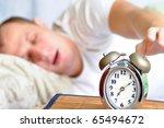 A Man Is Sleeping With An Alar...