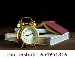 alarm clock standing and stack... | Shutterstock . vector #654951316