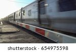 commuter train travel past... | Shutterstock . vector #654975598