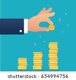 hand holding coin and build... | Shutterstock .eps vector #654994756