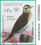 Small photo of SARABURI, THAILAND-JUNE 01,2017: Postage stamps had been printed in Lao People's Democratic Republic shows image of a Alauda arvensis bird, circa 1990