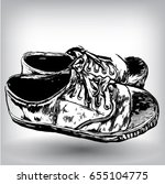 dirty canvas sneakers hand... | Shutterstock .eps vector #655104775