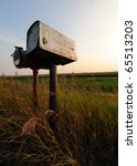 Two Old Tin Mailboxes In The...