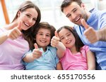 happy family at home  | Shutterstock . vector #655170556