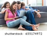 family using laptop at home  | Shutterstock . vector #655174972