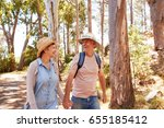 mature couple hiking along... | Shutterstock . vector #655185412