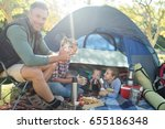 smiling family having snacks... | Shutterstock . vector #655186348