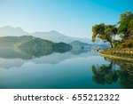 reflection of trees  mountains  ... | Shutterstock . vector #655212322