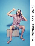 tourist sitting on a suitcase... | Shutterstock . vector #655255246