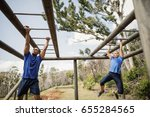 fit man and woman climbing... | Shutterstock . vector #655284565