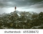 man on a mountain of trash | Shutterstock . vector #655288672