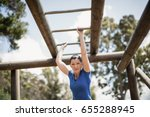 fit woman climbing monkey bars... | Shutterstock . vector #655288945
