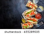 a lot of hotdogs on the table ... | Shutterstock . vector #655289035