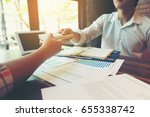 businessmen are receiving... | Shutterstock . vector #655338742