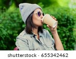 brunette young female in a hat... | Shutterstock . vector #655342462