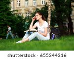 smiling girl student in city... | Shutterstock . vector #655344316
