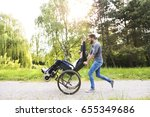 hipster son running with... | Shutterstock . vector #655349686