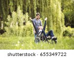 hipster son walking with... | Shutterstock . vector #655349722