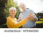 portrait of happy senior couple ... | Shutterstock . vector #655360282