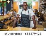 portrait of smiling waiter... | Shutterstock . vector #655379428
