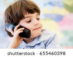 Small photo of young boy phoning