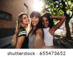 outdoor shot of three young... | Shutterstock . vector #655473652