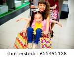 happy family shopping | Shutterstock . vector #655495138