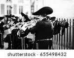 Small photo of Street performing mariachis. Trumpeter in the front of mariachi band.