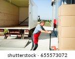 logistics worker carrying...   Shutterstock . vector #655573072