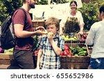 little boy biting fresh green...   Shutterstock . vector #655652986