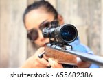 the woman at the shooting range ... | Shutterstock . vector #655682386