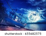 an old wooden fishing boat on a ... | Shutterstock . vector #655682575