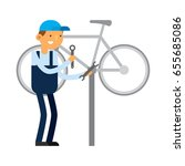 bicycle repair guy | Shutterstock .eps vector #655685086