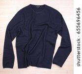 wrinkled blue navy sweater on... | Shutterstock . vector #655696456