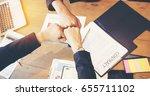team business partners giving... | Shutterstock . vector #655711102