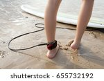 female legs with surfboard on... | Shutterstock . vector #655732192