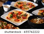 pizza during buffet | Shutterstock . vector #655762222