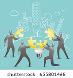 group of men piecing together a ... | Shutterstock .eps vector #655801468