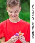 young teen boy holding popular...   Shutterstock . vector #655861996